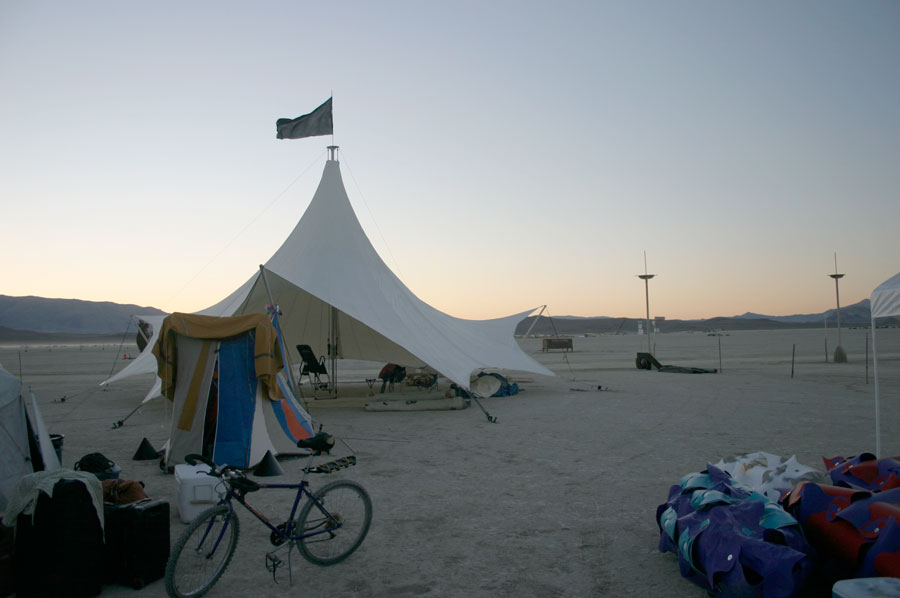 "This tent has been out to the Blackrock desert for several years, it's withstood brutal dust storms, caustic alkali clay in every crevice and baking sun. The colurful blob in the front is my personal tent ""experiment"" it has a hammock suspended inside and is made of salvaged fabrics."