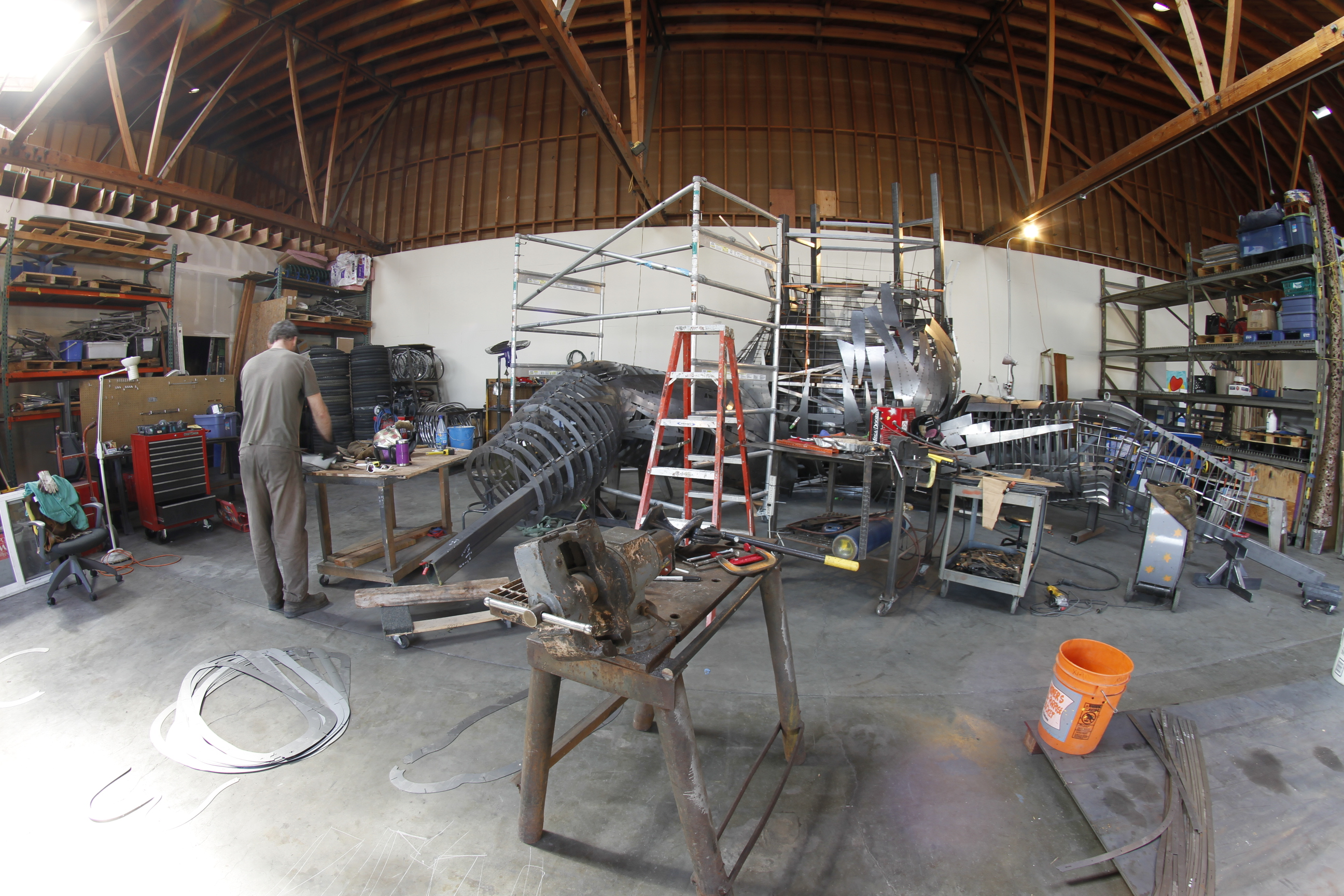 "Shot of the build. all of the ribs were generated in rhino, split in to two or more pieces and numbered, each rib has a locating hole to make measurements to the structure underneath by dropping a plumb line along the inner edge of the 6""x8"" leg ""bone"""